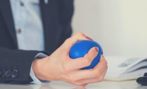 Pressing stress ball stop touching your face all the time